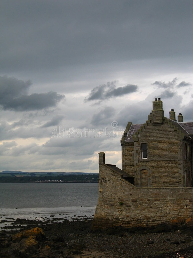 Blackness castle. In stormy sky background royalty free stock image