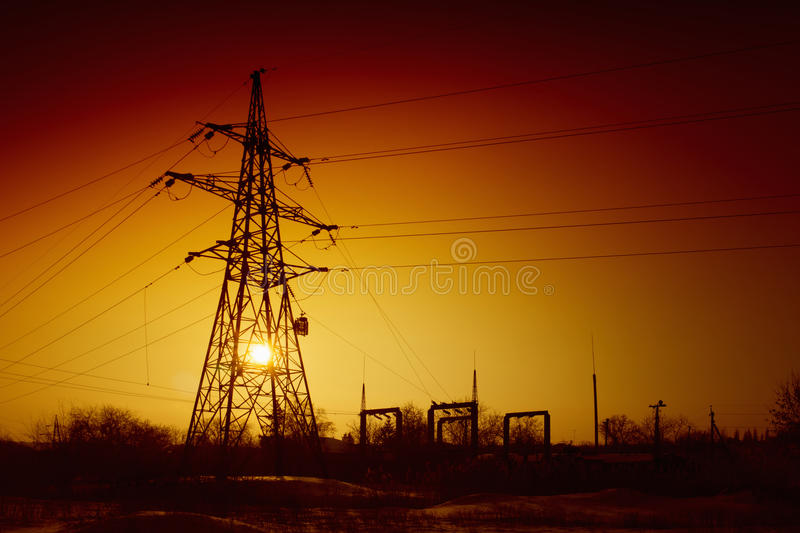 Blackout concept, power failure. Power lines on sunset, electrical power supply, blackout concept, red sky royalty free stock photography