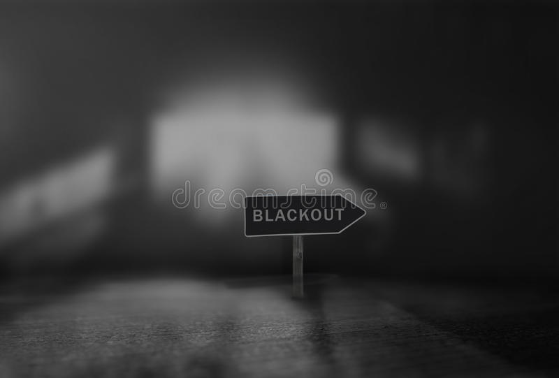 Blackout. Sign on dark background royalty free stock photos