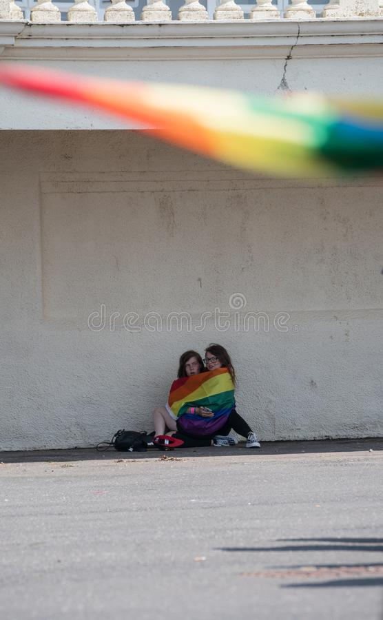 Two girls in rainbow flag at Blackpool Pride festival royalty free stock photos