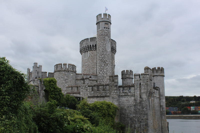 Blackrock Castle Cork Ireland side view. With trees and the sea royalty free stock photography