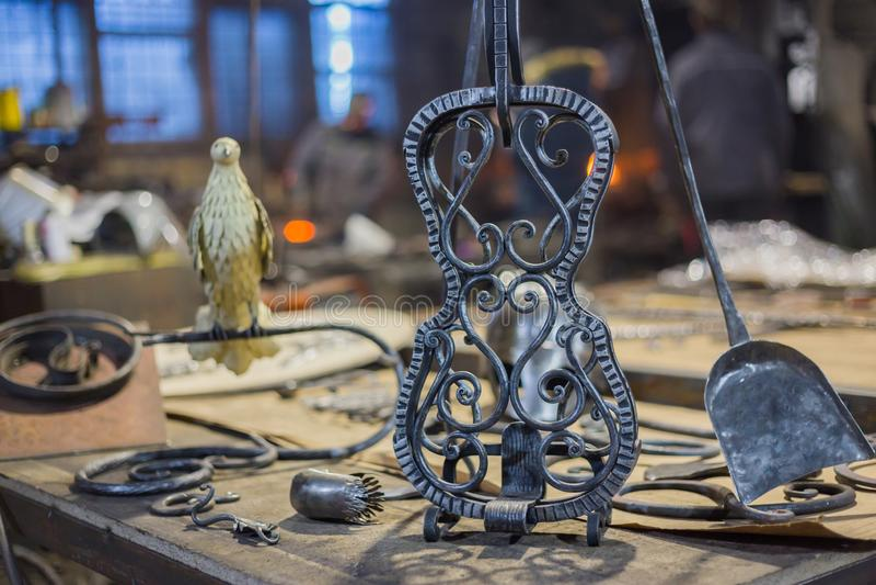 Blacksmith decorative elements. At forge, workshop. Handmade, craftsmanship and blacksmithing concept stock photo