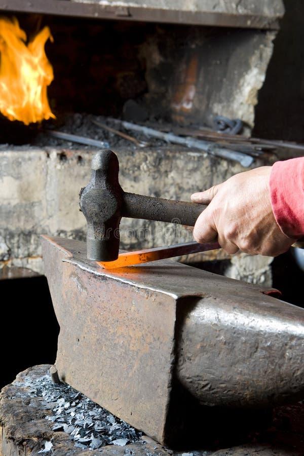 Blacksmith Hammering A Steel stock photography