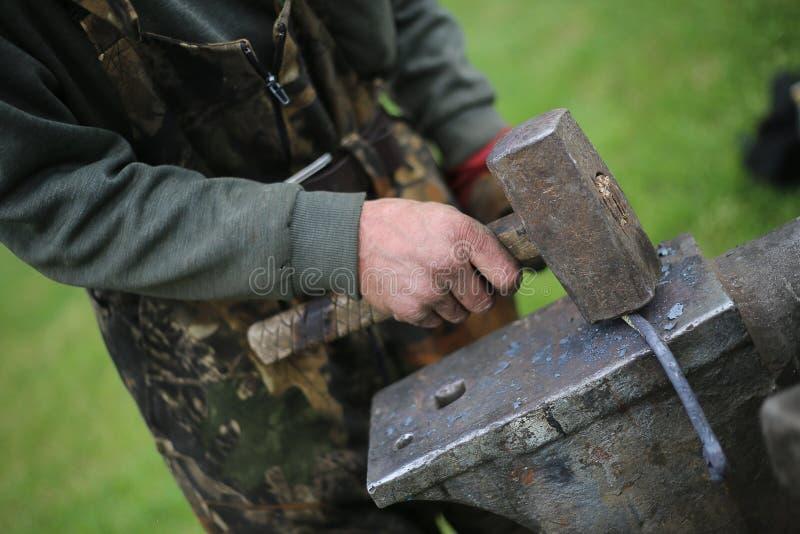 Blacksmith. The blacksmith knocks on the anvil stock photography