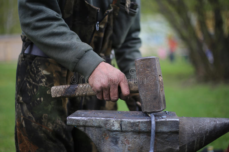 Blacksmith. The blacksmith knocks on the anvil stock images