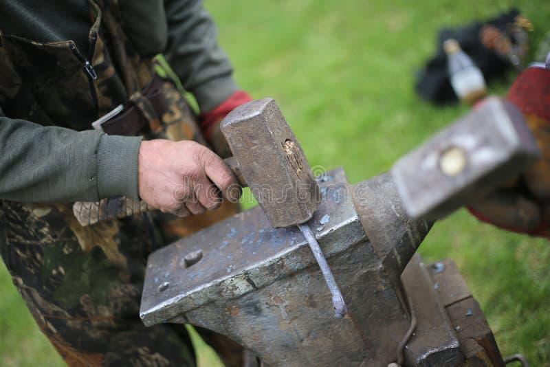 Blacksmith. The blacksmith knocks on the anvil royalty free stock photography