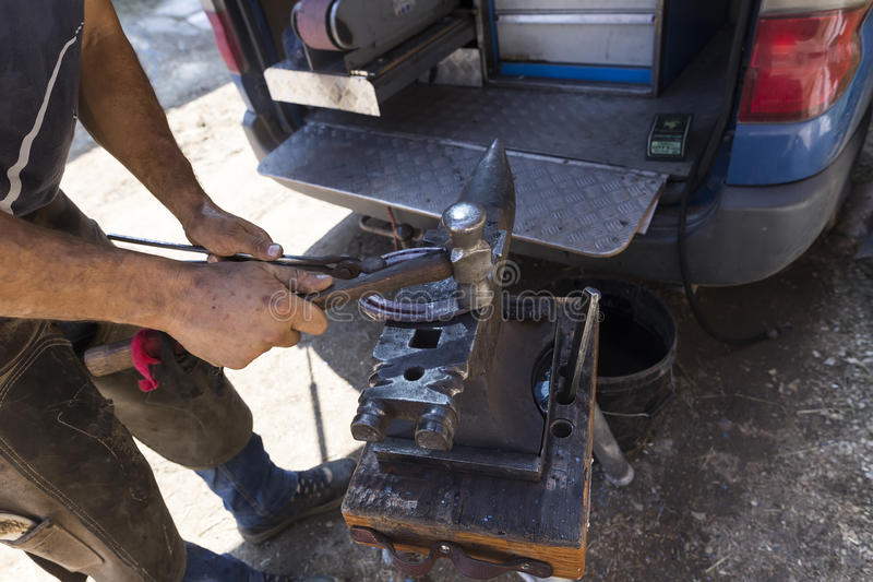 Blacksmith making horseshoes before the competition matches ridi. Thessloniki, Greece, June 14, 2015: Blacksmith making horseshoes before the competition matches stock images