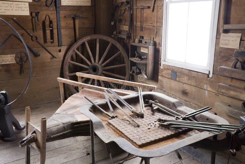 Blacksmith shop. Interior of old blacksmith shop with various tools royalty free stock photos