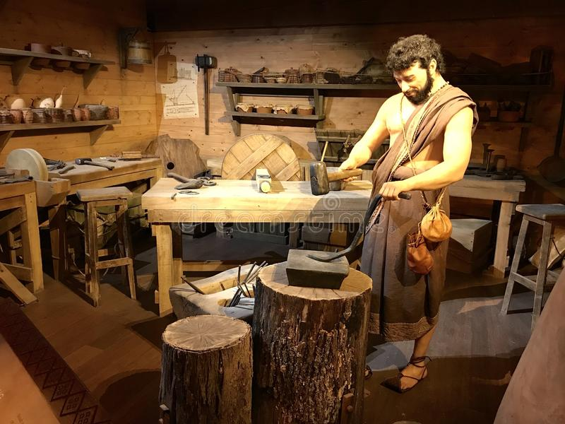 Blacksmith Working on the Ark Encounter Theme Park. Williamstown, KY, USA - November 3, 2017: Blacksmith workshop on the Noah`s ark replica at the Ark Encounter stock photography