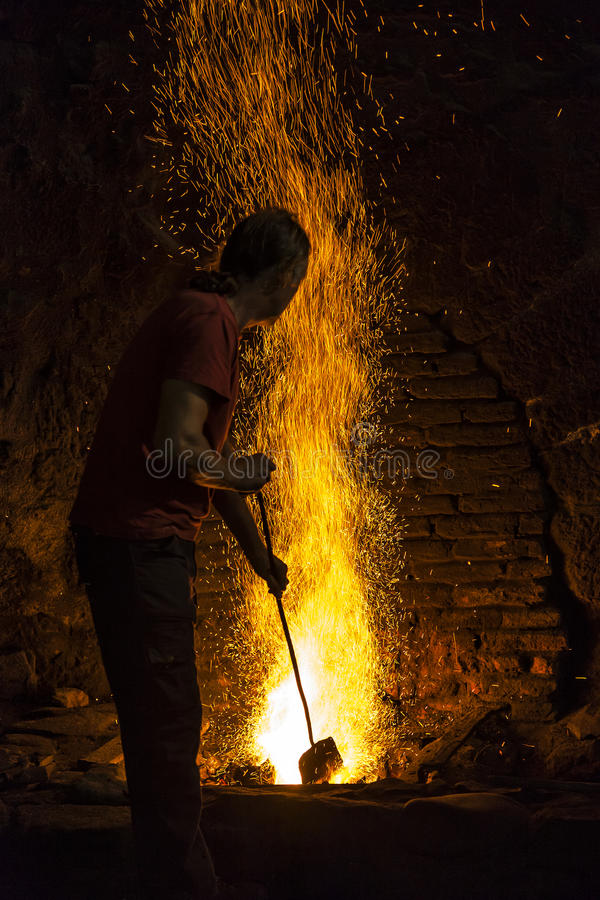 Blacksmith working at the forge royalty free stock photos