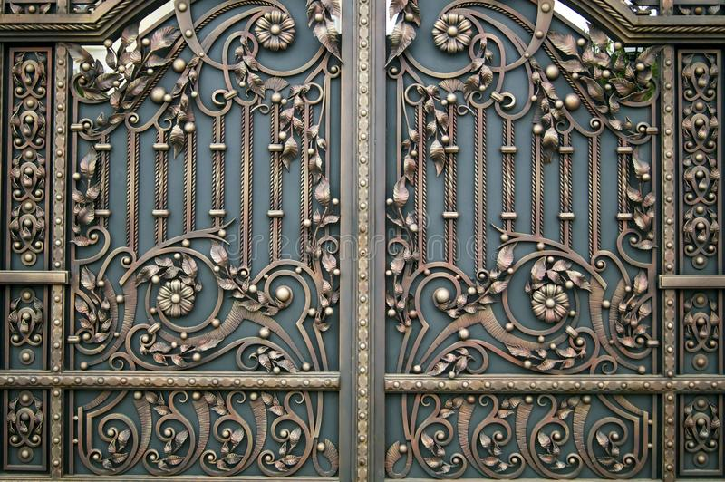Decorative beautiful forged metal gate finishing elements royalty free stock images