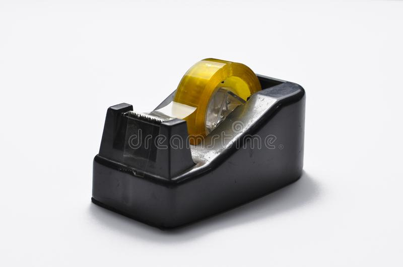 Black tape dispenser cutter of office stationery isolated on white background. Tape cutter.Copy space royalty free stock photography