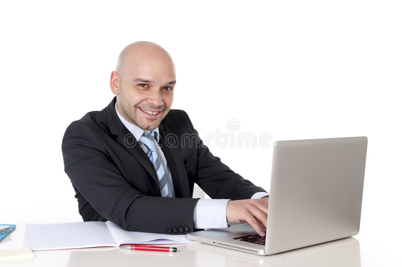 Blad happy latin businessman working on laptop smiling camera stock image