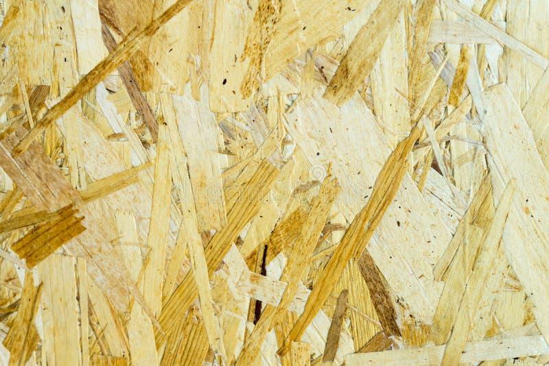 Blad van triplex met fragmenten van samengeperst zaagsel stock afbeelding