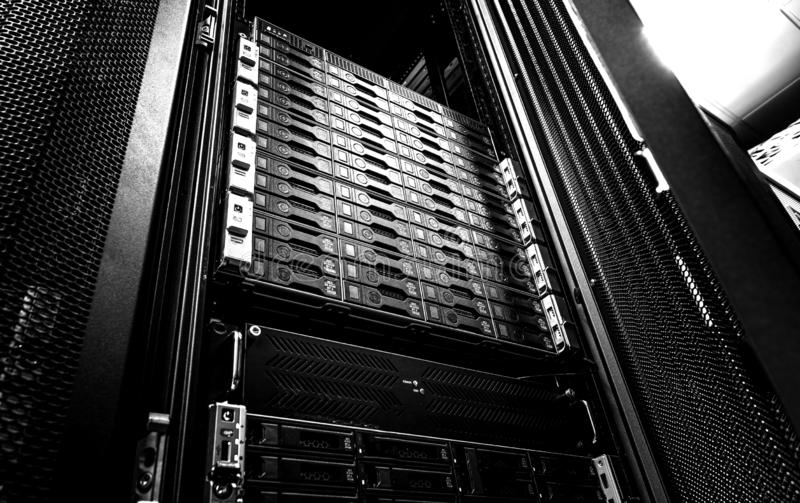Blade server in rack cluster hard drives storage in internet data center room black and white tone royalty free stock images