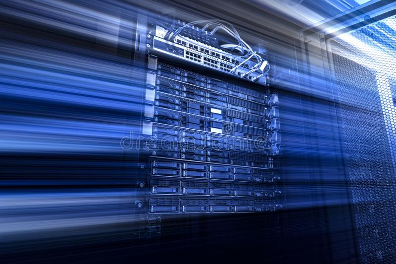 Blade server in rack cluster hard drives storage tapes in internet data center room motion blue stock photography