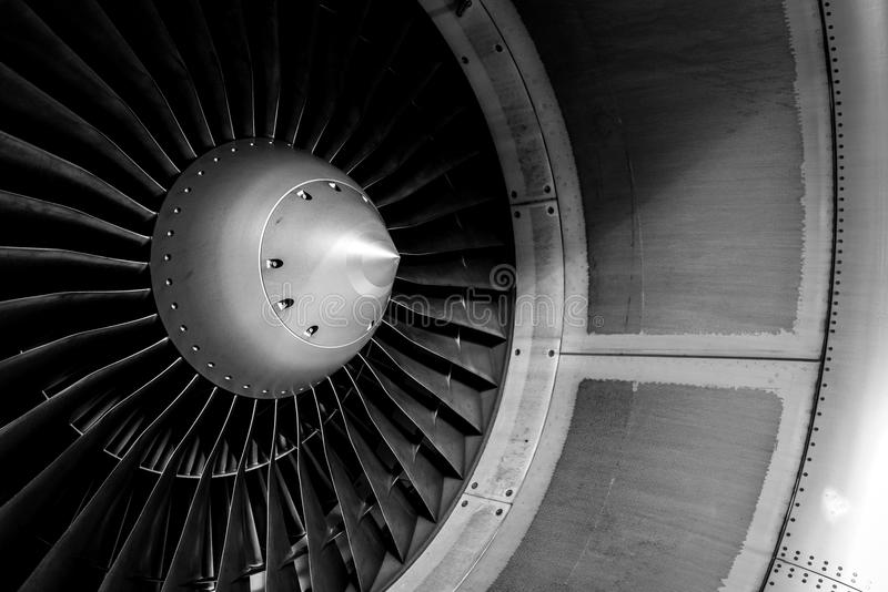 Blades of an aircraft engine close-up. Travel and aerospace concept. Black and white filter stock image
