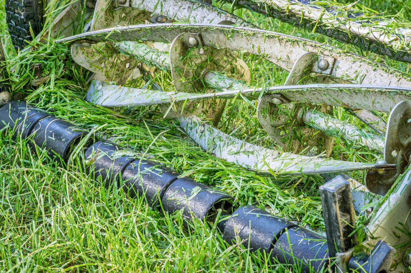 Blades hand lawn mower. Blades of push reel lawn mower with grass clips royalty free stock images