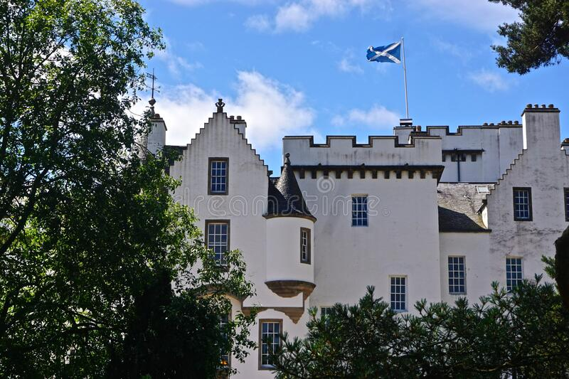 Blair Athol, Scotland: The flag of Scotland flies over Blair Castle. A 13th-century stronghold in the Scottish Highlands royalty free stock photo
