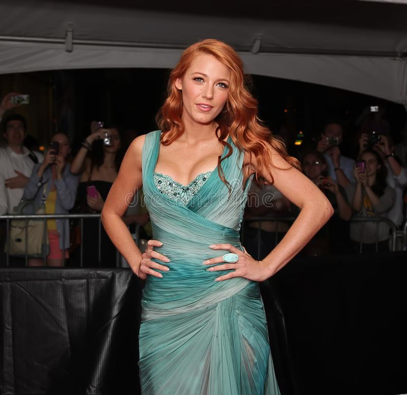Blake Lively. Actress and model Blake Lively changed her blonde locks to red tresses as she arrived on the red carpet outside the Time Warner Center in mid-town stock images