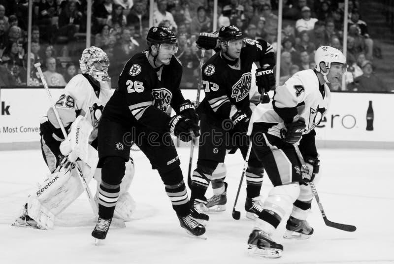Blake Wheeler. Boston Bruins forwards Blake Wheeler (26) and Michael Ryder (73) camp out front of Penguins goalie Marc-Andre Fleury stock photography