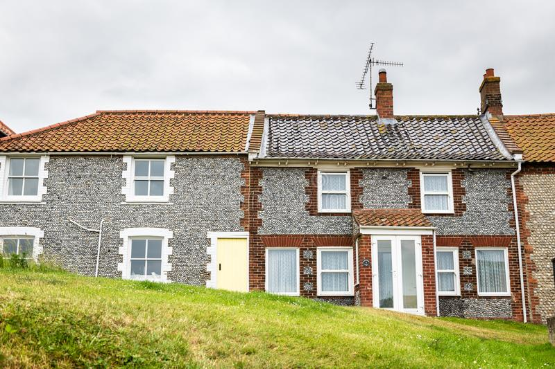 Blakeney cottages in North Norfolk. Traditional flint cottages in Blakeney, a coastal village and civil parish in the English county of Norfolk stock image