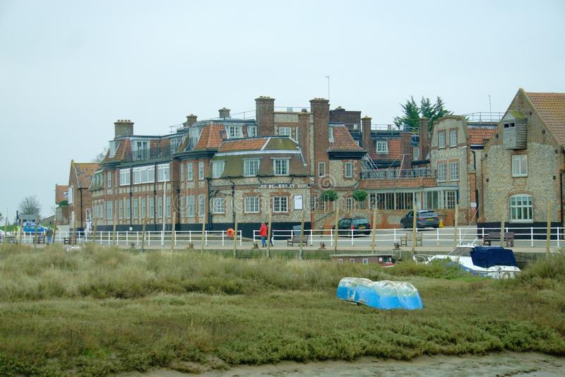 Blakeney flint cottages and marsh. Picture of the popular tourist destination of the coastal village Blakeney on the north Norfolk coast. It is a picturesque royalty free stock photos
