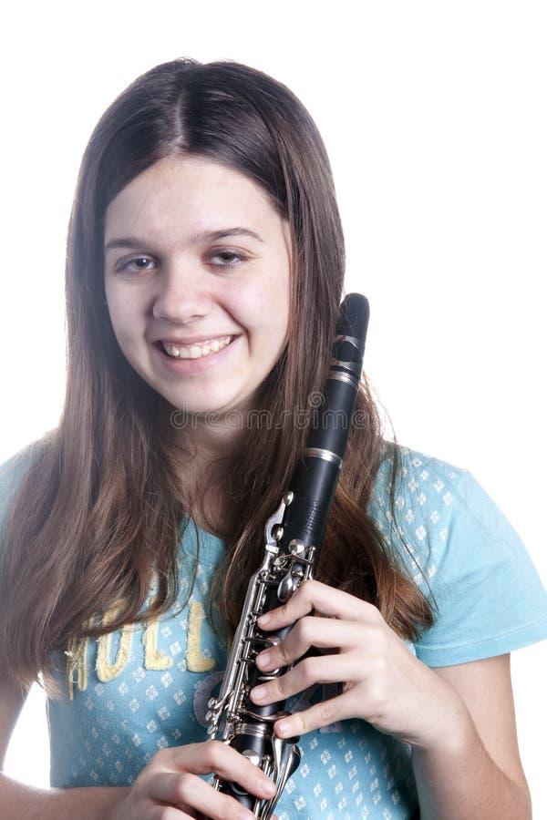 blanc d'adolescent de fille de clarinet photo stock
