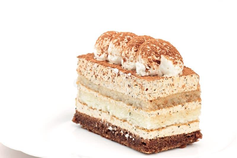 Download Blanc D'isolement Par Gâteau Photo stock - Image du lait, cuisine: 8667890