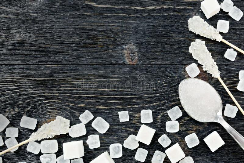 Blanc de sucre sur le cadre noir de conseil photographie stock libre de droits