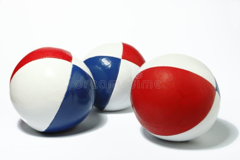 Blanc rouge et billes de jonglerie bleues images libres de droits