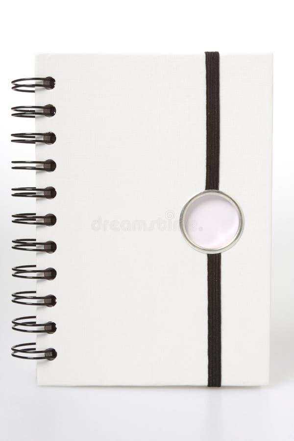 blanc spiralé de cahier images stock