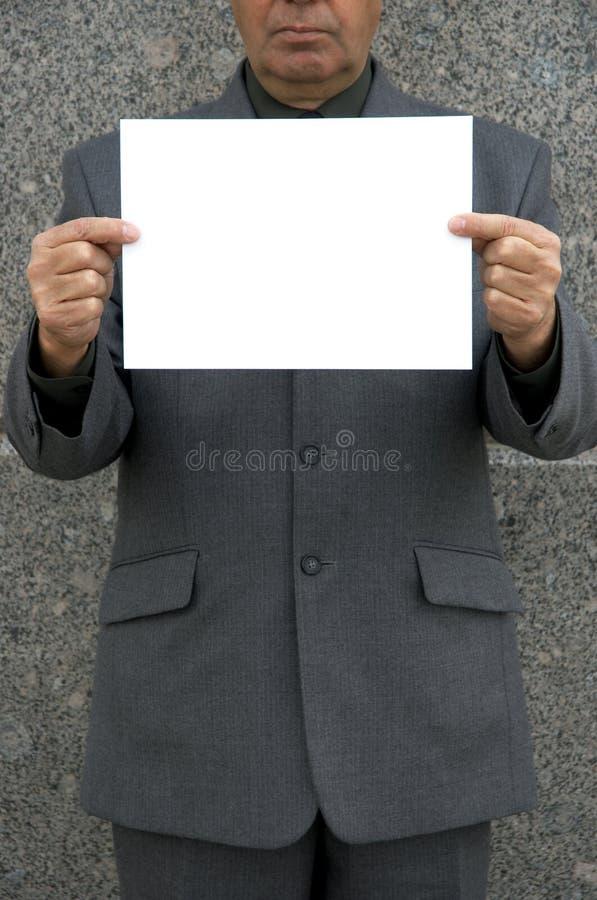 Blanc vide dans des mains photos stock