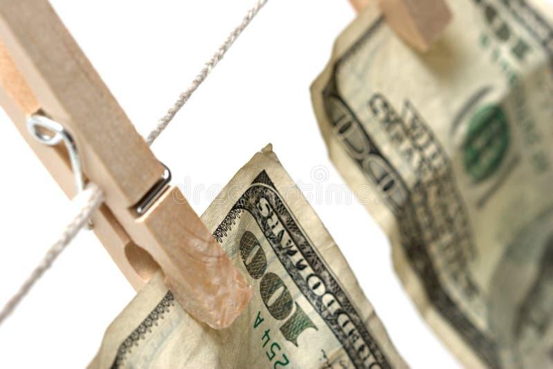 Blanchissage d'argent au-dessus du blanc photographie stock