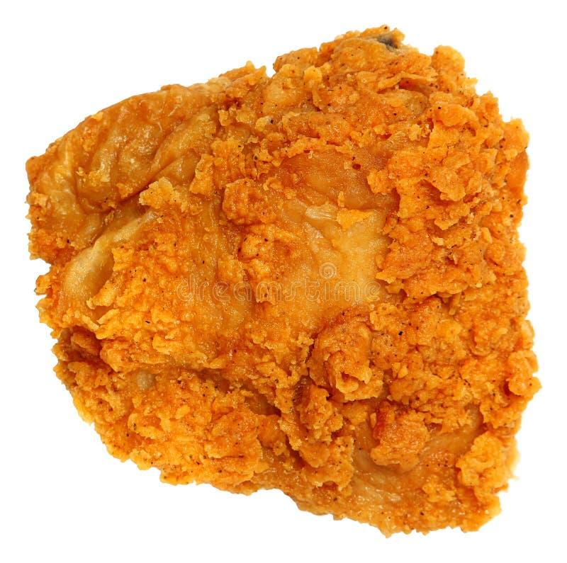 Blanco curruscante de Fried Chicken Thigh Isolated Over de la visión superior foto de archivo libre de regalías
