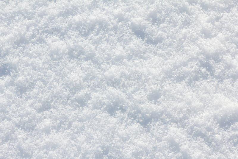 Blanco del fondo de la nieve en día de invierno La estación del tiempo frío, texturiza el extracto fotos de archivo libres de regalías