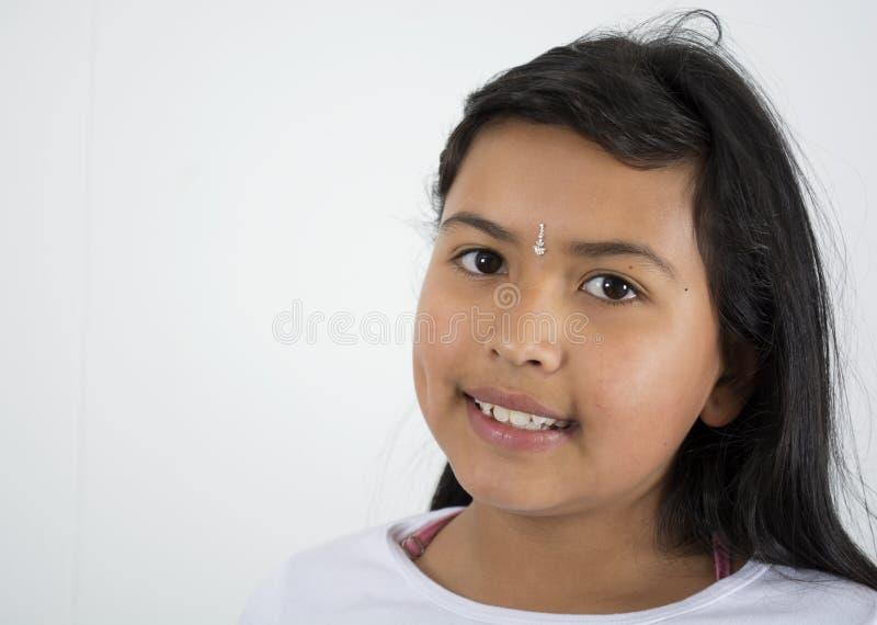 Blanco excesivo feliz del niño indio de la muchacha fotografía de archivo