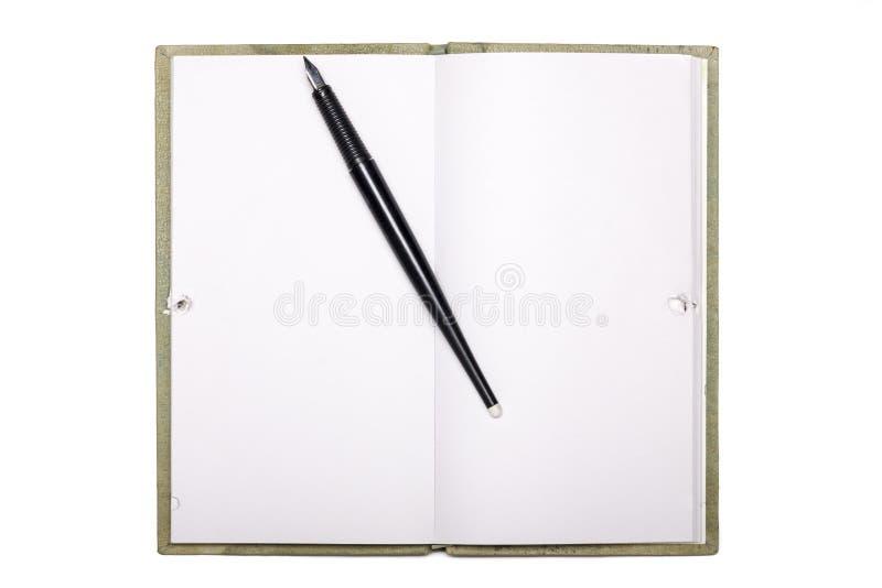 Blanco pagina van notaboek met zwarte pen die op wit wordt geïsoleerd stock foto's