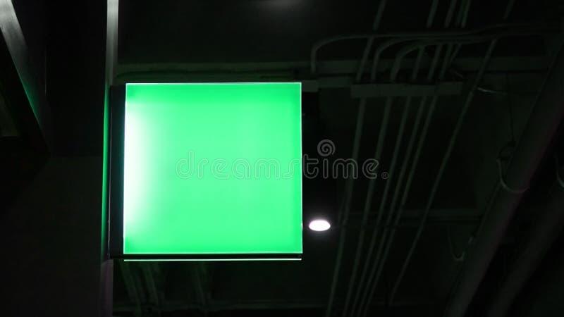 Blanco vierkant met lampje aan wand hangen royalty-vrije stock fotografie