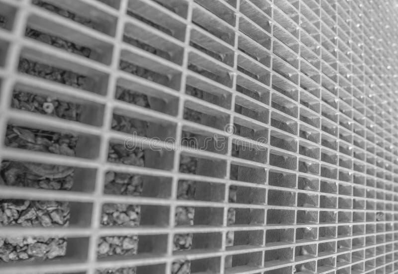 Blanco y negro, textura, primer cuadrado de acero de la parrilla foto de archivo libre de regalías
