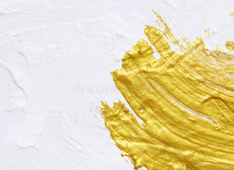 Blanco y pintura texturizada acrílico del oro foto de archivo