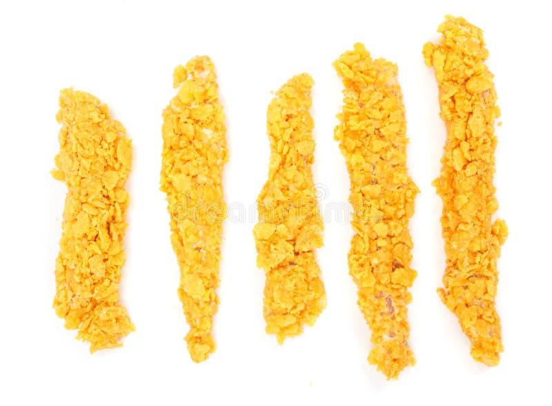 Blancs de poulet panés par cornflake cru photo stock