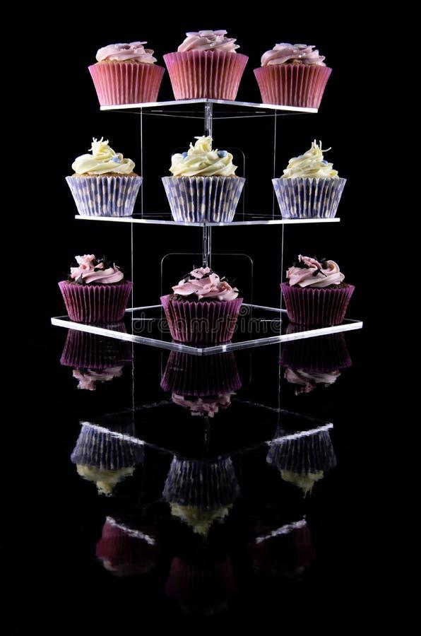 blandad cakeskoppstand royaltyfri foto