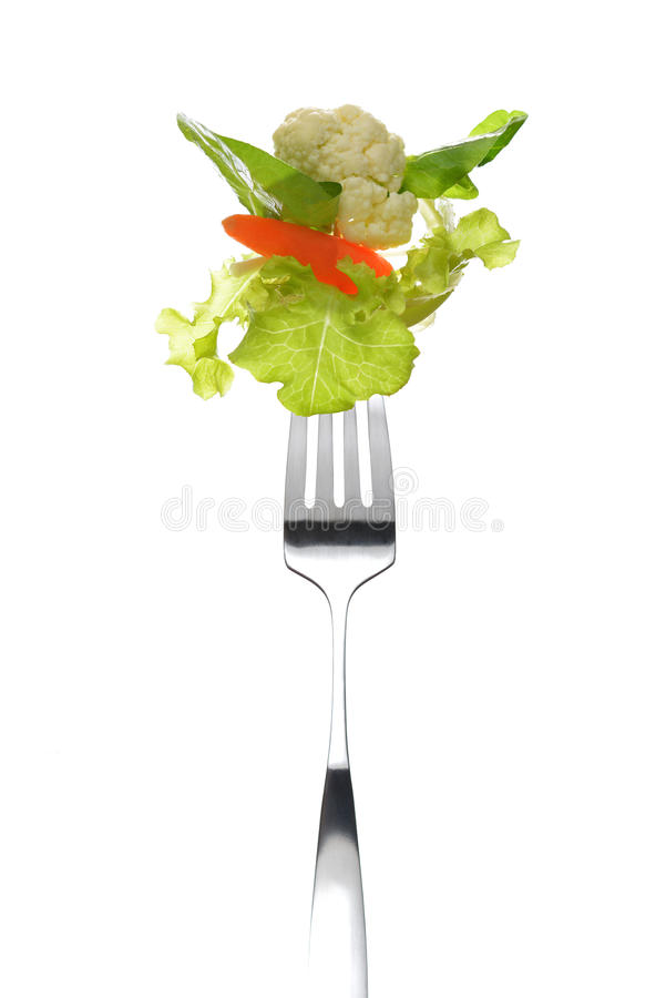 Blandad sallad på gaffel arkivfoto