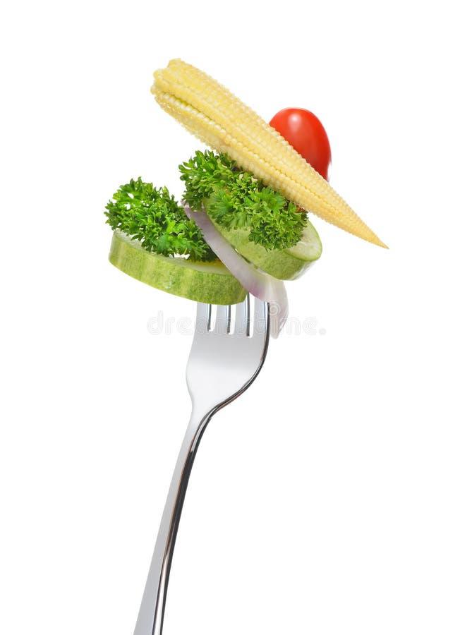 Blandad sallad på gaffel arkivfoton