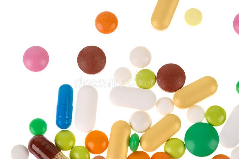 Blandade farmaceutiska medicinpreventivpillerar, minnestavlor och kapslar serie f?r bakgrundsaff?rspills arkivfoto