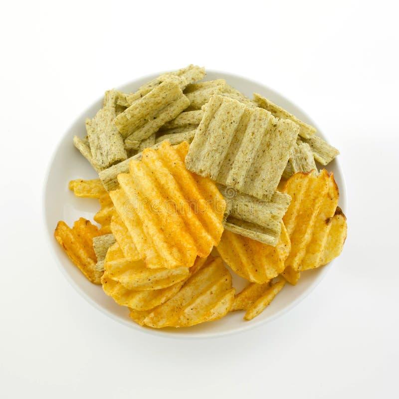 Blandat chips och sädesslag för havreflinga på vit bakgrund royaltyfri fotografi