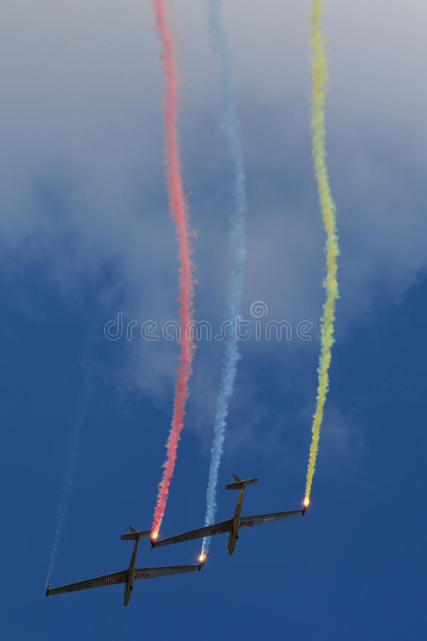 Blanix - Aerobatic Glider Team Performing With Smoke / Red Bull stock photography