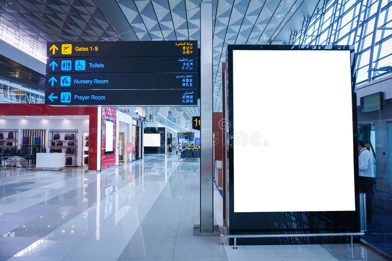 Blank advertising billboard at airport stock images
