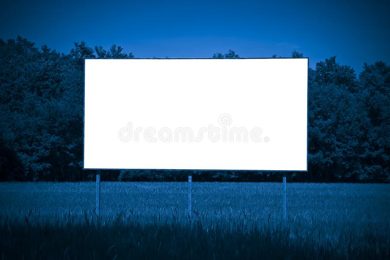 Blank advertising billboard immersed in a rural scene - image wi. Th copy space stock photography